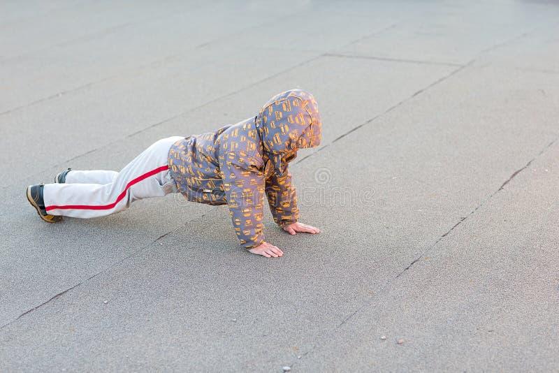 Boy making pushap stock photo