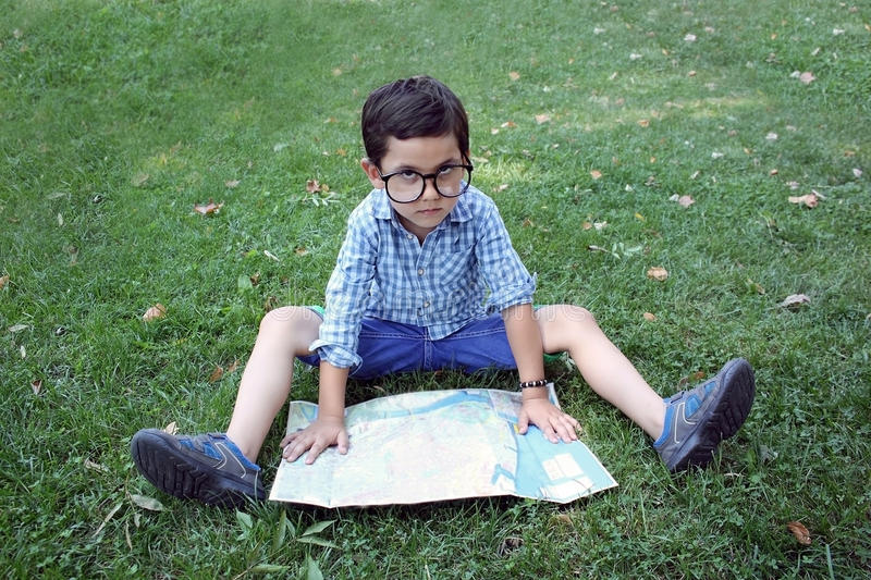 Boy with map stock photo