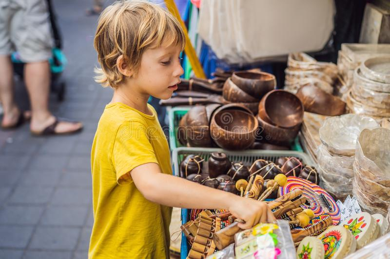 Boy at a market in Ubud, Bali. Typical souvenir shop selling souvenirs and handicrafts of Bali at the famous Ubud Market royalty free stock photo