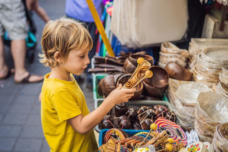Boy at a market in Ubud, Bali. Typical souvenir shop selling souvenirs and handicrafts of Bali at the famous Ubud Market stock photos