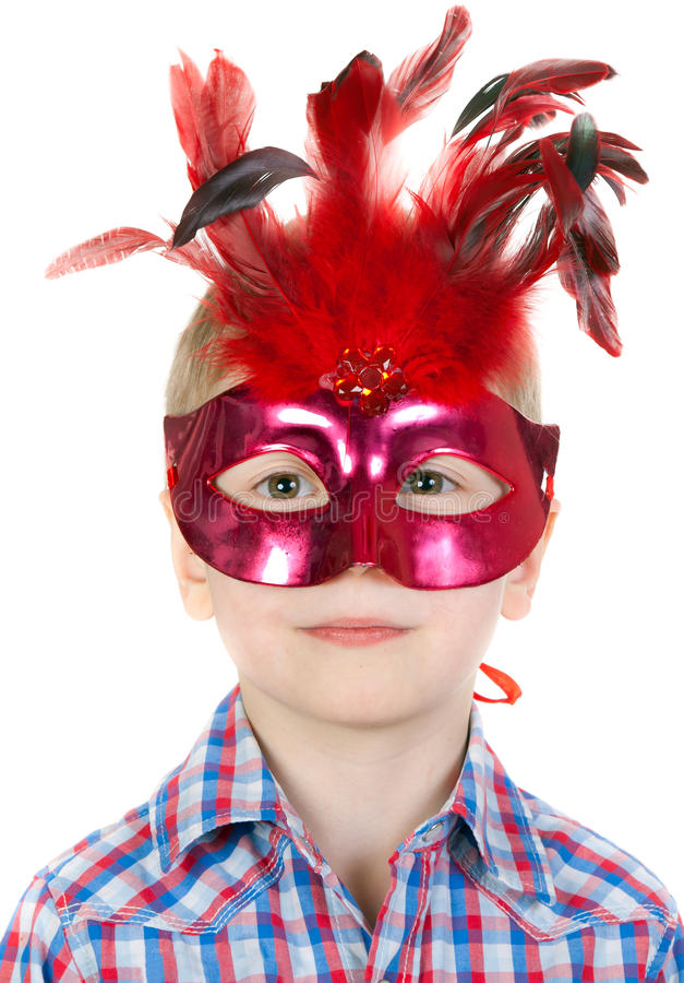 The Boy in the masquerade mask with feathers stock photo
