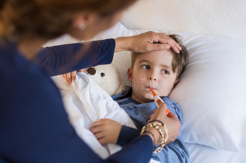 Boy measuring fever stock image