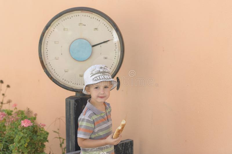 Boy with old scales royalty free stock photos