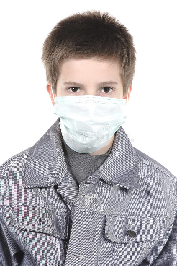 Boy in a medical mask. stock images