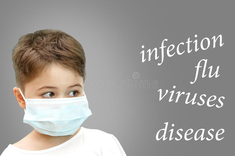 Boy in the medical mask on his face next to the name of diseases on isolated background stock photo