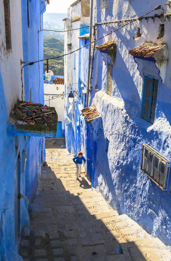 A boy at Medina of Chefchaouen, Morocco. The Medina de Chefchaouen - also known as Chaouen or Xauen - is a small and calm evironment.When entering one of the royalty free stock photography