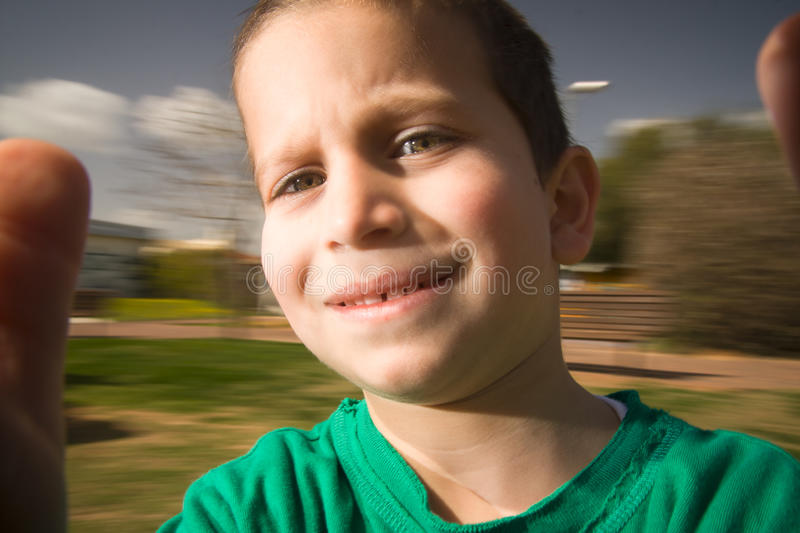 Boy on merry go round. Boy with blue eyes on merry go round stock photography