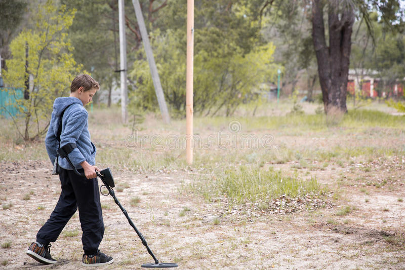Boy with a metal detector royalty free stock photography