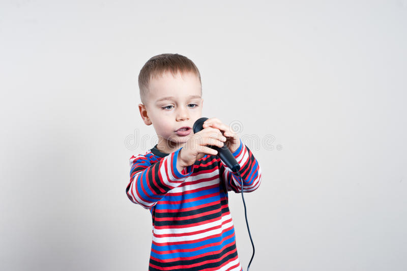 Boy with microphone stock photos