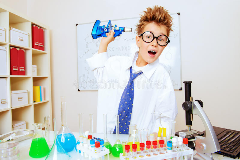 Boy with microscope stock image