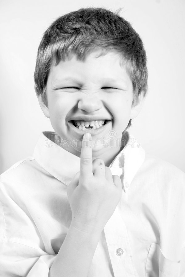 Boy with missing tooth royalty free stock images