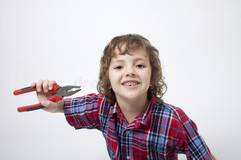 Boy With Missing Tooth And Combination Pliers Stock Images