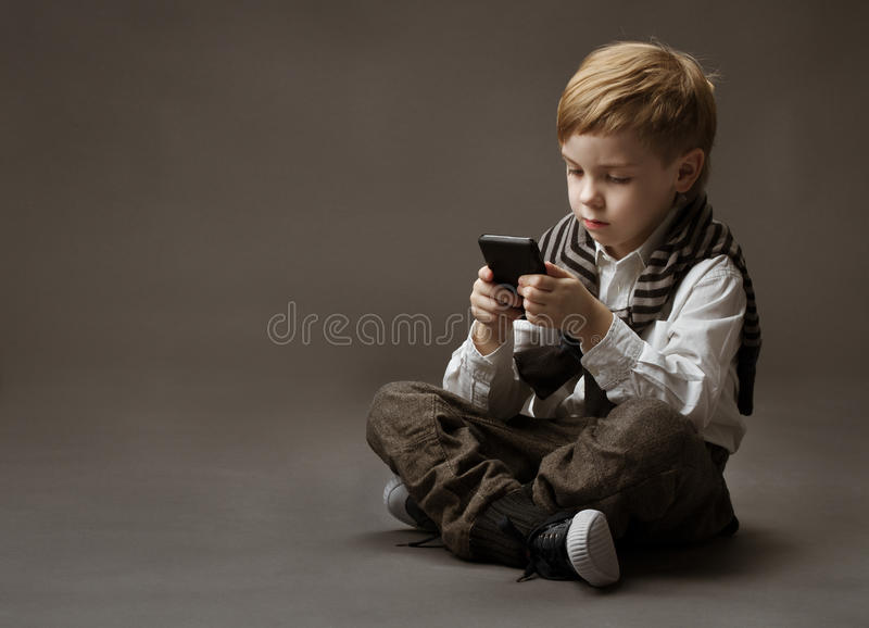 Download Boy With Mobile Phone Stock Photography - Image: 29139662