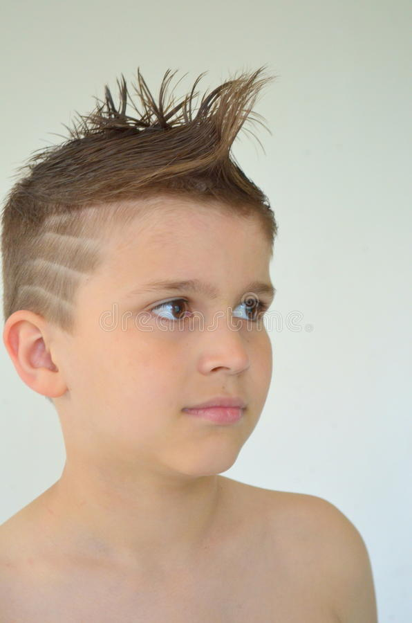 Boy with mohawk hairstyle royalty free stock photo