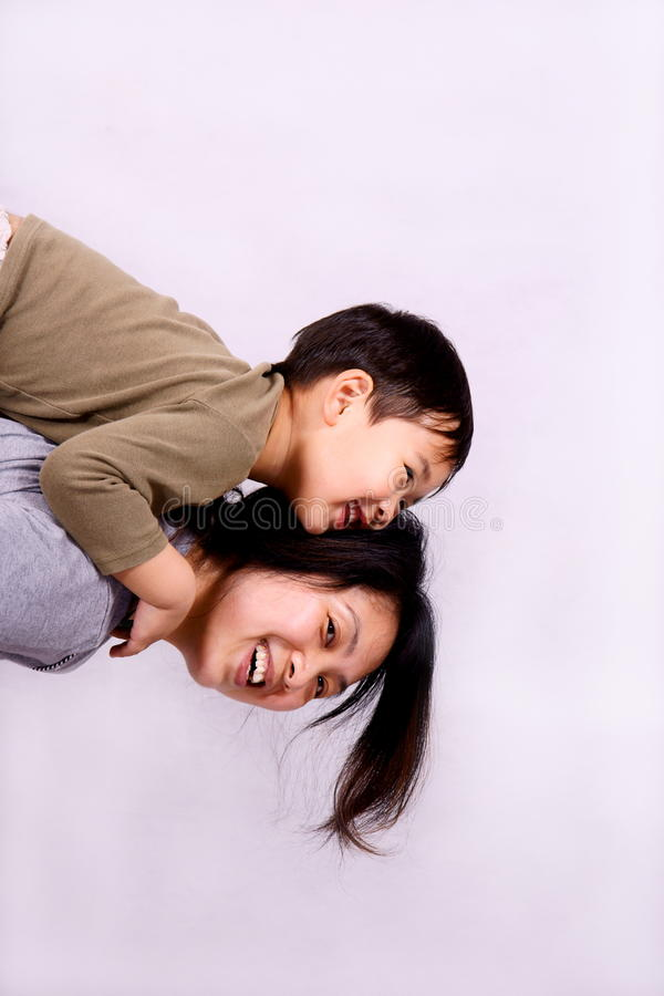 Boy and mother stock photography