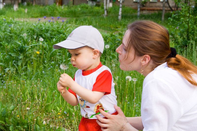 Boy with mother and dandelion royalty free stock photo