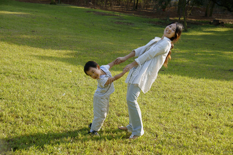Download Boy And Mother Having Fun On Lawn Stock Photo - Image: 11199244