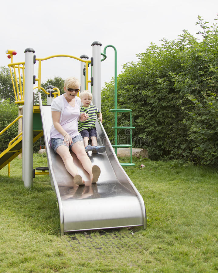 Download Boy with mother on slide stock image. Image of playful - 26283647