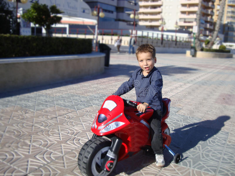 A boy on a moto royalty free stock images