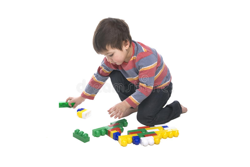Boy with multicolored bricks royalty free stock images