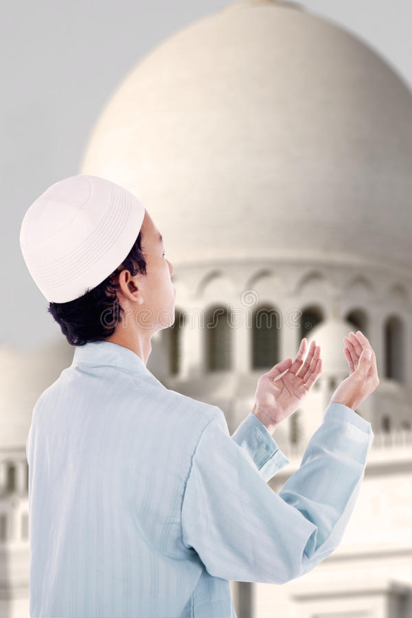 Boy muslim praying at mosque. Asian muslim boy is praying at mosque stock illustration