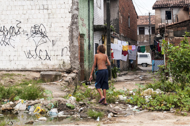 Boy in a neighborhood suburban. Boy in a poor and dirty neighborhood of suburbs, Fortaleza, Brazil FORTALEZA, CE - MAY 14: Unidentified boy in a poor and dirty royalty free stock photography