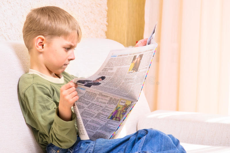 Boy with newspaper stock images