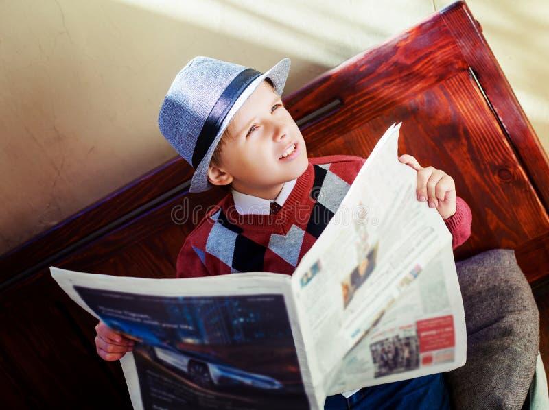 Boy with newspaper stock photo