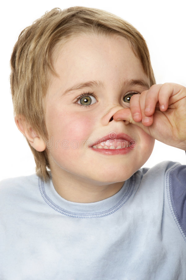 Boy nose. Boy thumbing nose stock photos