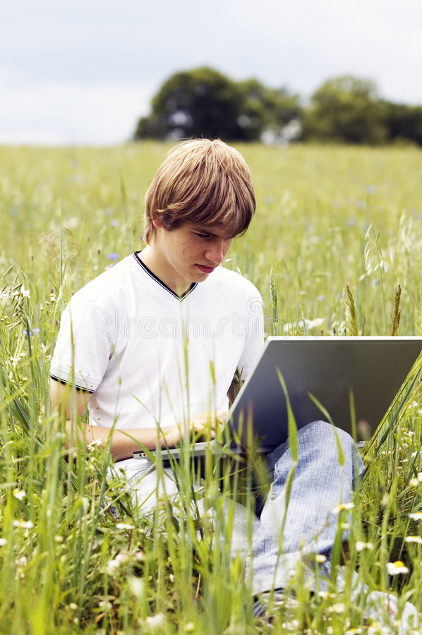 Boy With Notebook On The Field Stock Photo