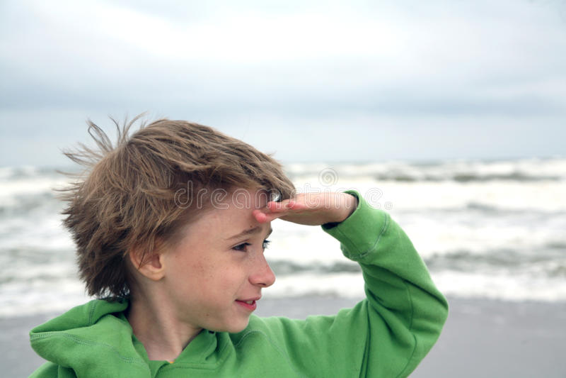 Boy observing new horizons royalty free stock photo