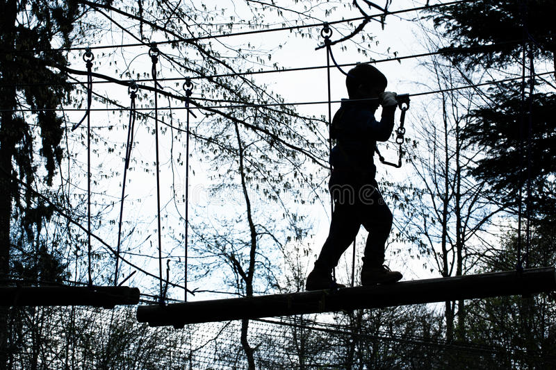 Boy on obstacle course stock photos
