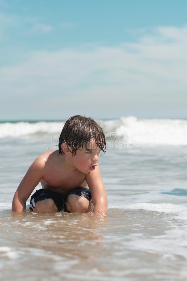 Download Boy at Ocean Beach stock image. Image of youth, suit - 23939109