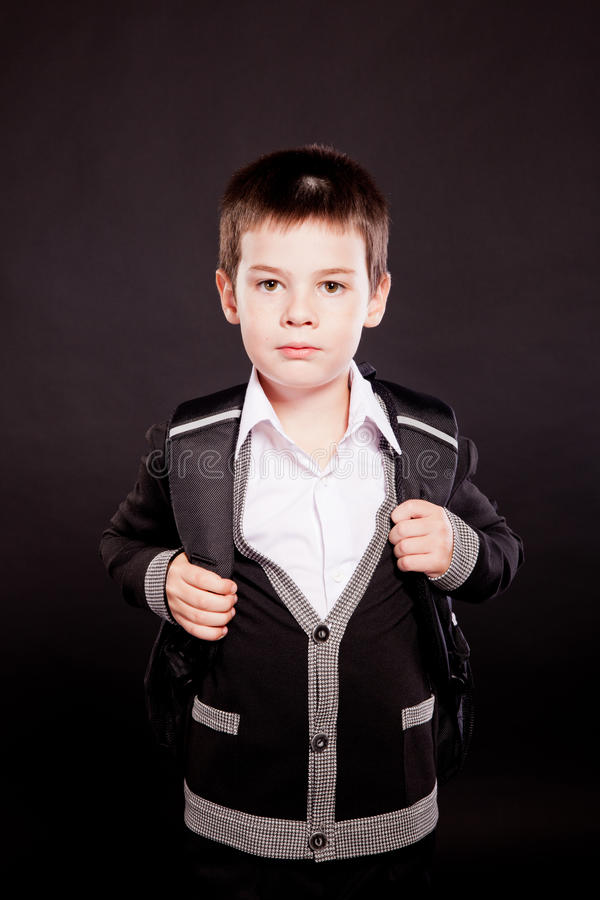 Download Boy In Official Dresscode With Backpack Stock Photo - Image of little, color: 22351610