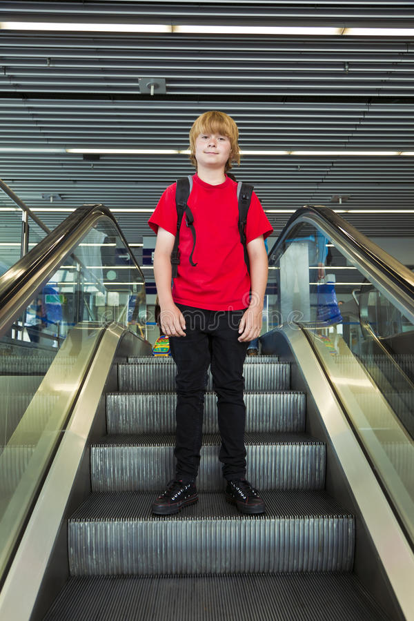 Free Boy On A Moving Staircase Stock Photography - 21060582