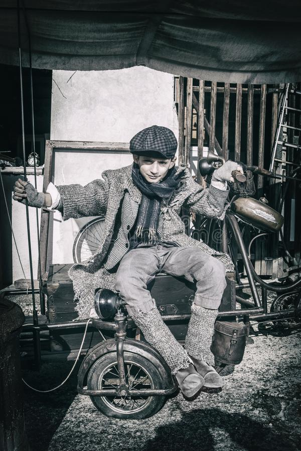 Free Boy On Old Fashioned Bicycle Stock Photo - 118336980