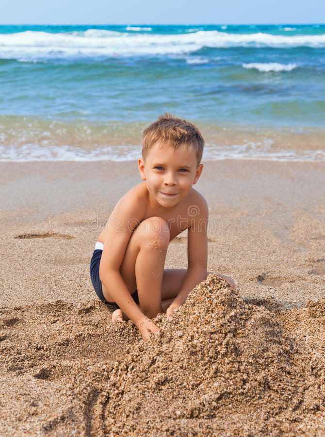 Free Boy On The Beach With Sand Royalty Free Stock Photos - 21707358