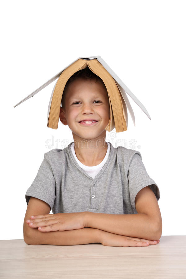 Boy with open book on head stock photography