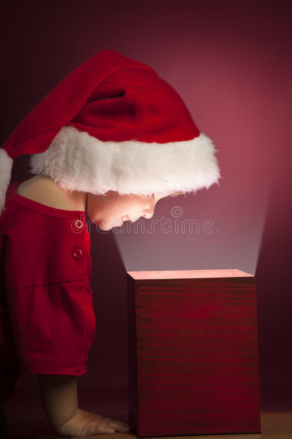 Boy open christmas gift-box royalty free stock image