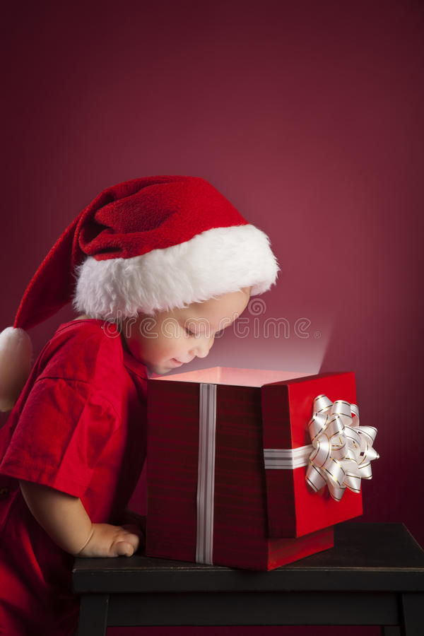 Boy open christmas gift-box royalty free stock photography