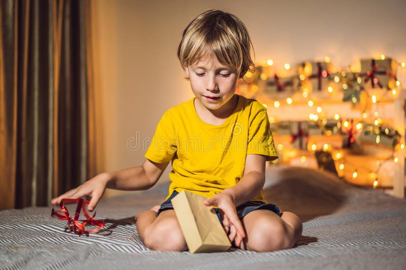 The boy opens a gift from the advent calendar.  royalty free stock photography