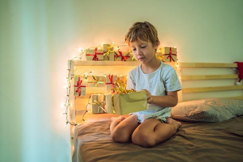 The boy opens a gift from the advent calendar.  royalty free stock image
