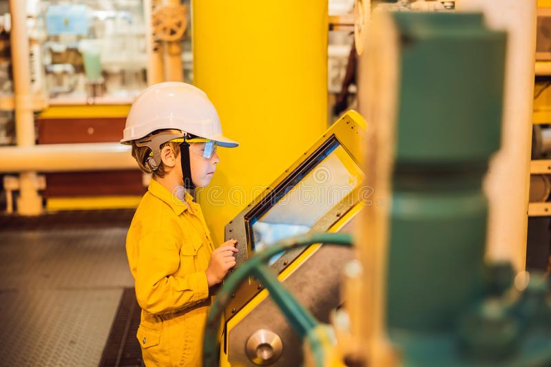 Boy operator recording operation of oil and gas process at oil and rig plant, offshore oil and gas industry, offshore. Oil and rig in the sea, operator monitor stock images