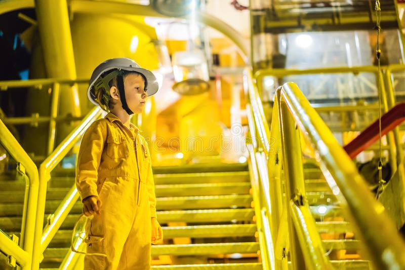 Boy operator recording operation of oil and gas process at oil and rig plant, offshore oil and gas industry, offshore. Oil and rig in the sea, operator monitor stock photography