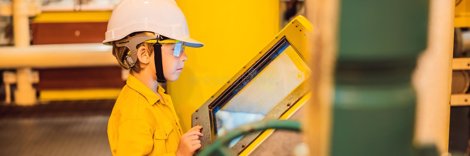 Boy operator recording operation of oil and gas process at oil and rig plant, offshore oil and gas industry, offshore stock photo