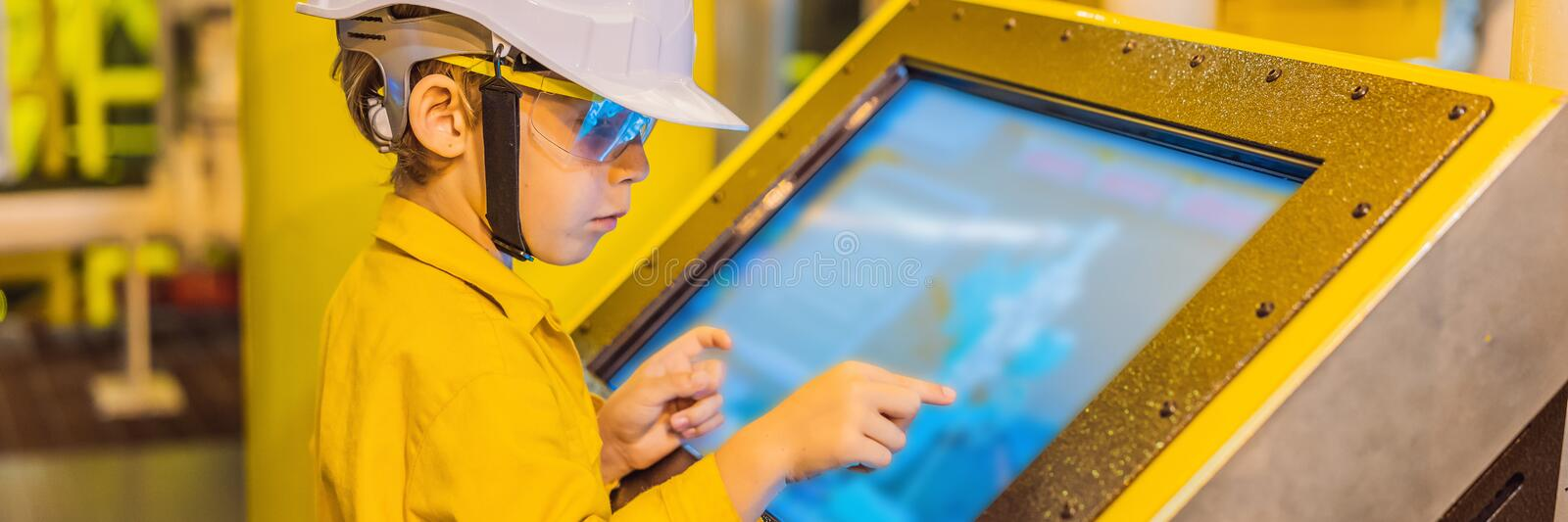 Boy operator recording operation of oil and gas process at oil and rig plant, offshore oil and gas industry, offshore. Oil and rig in the sea, operator monitor stock photos