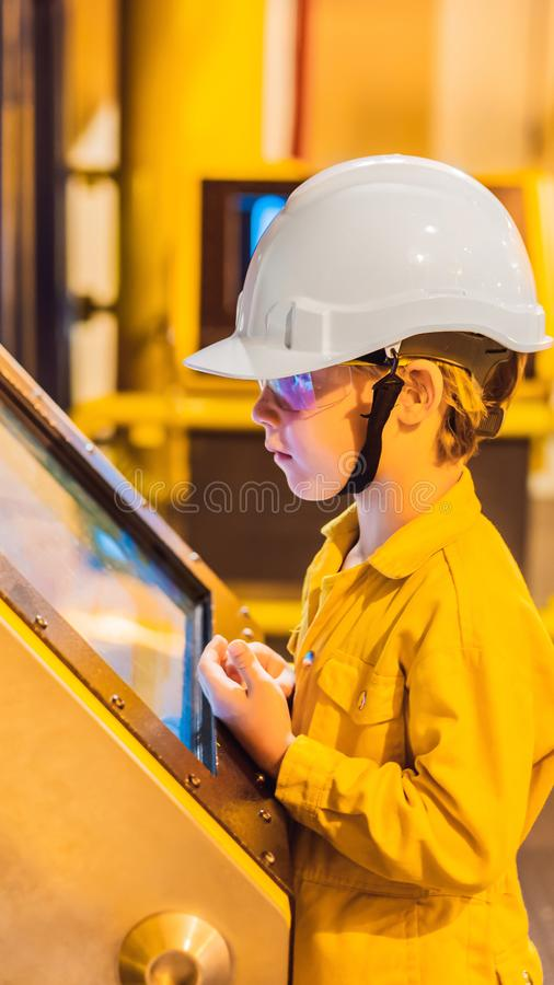 Boy operator recording operation of oil and gas process at oil and rig plant, offshore oil and gas industry, offshore royalty free stock image