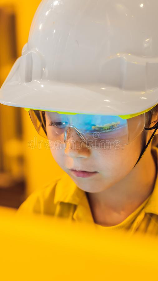 Boy operator recording operation of oil and gas process at oil and rig plant, offshore oil and gas industry, offshore stock photography