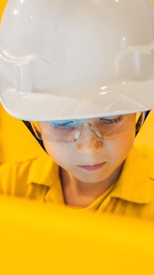Boy operator recording operation of oil and gas process at oil and rig plant, offshore oil and gas industry, offshore royalty free stock images