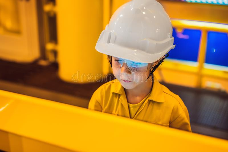 Boy operator recording operation of oil and gas process at oil and rig plant, offshore oil and gas industry, offshore. Oil and rig in the sea, operator monitor royalty free stock photo